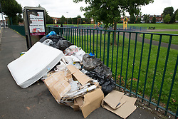 © Licensed to London News Pictures. 12/08/2016. Birmingham, UK. The strike by Birmingham bin men continues as they announce strike action up to Christmas. Pictured, rubbish building up in Taunton Road, next to Balsall Heath park. Photo credit: Dave Warren/LNP