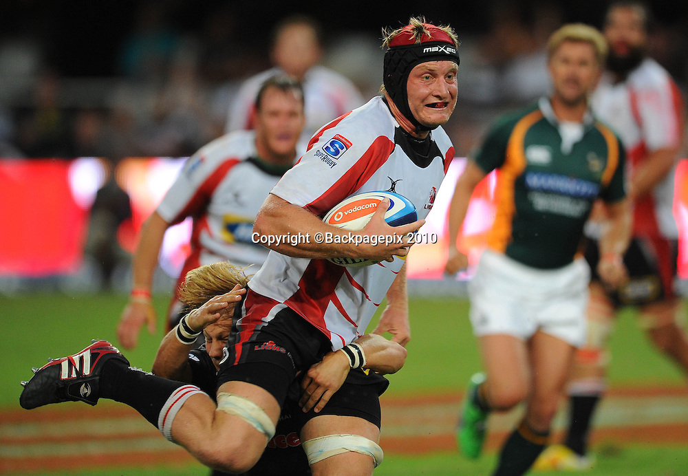 Franco van der Merwe of the MTN Golden Lions tackled by Charl McLeod of the Sharks <br /> &copy;Chris Ricco/Backpagepix