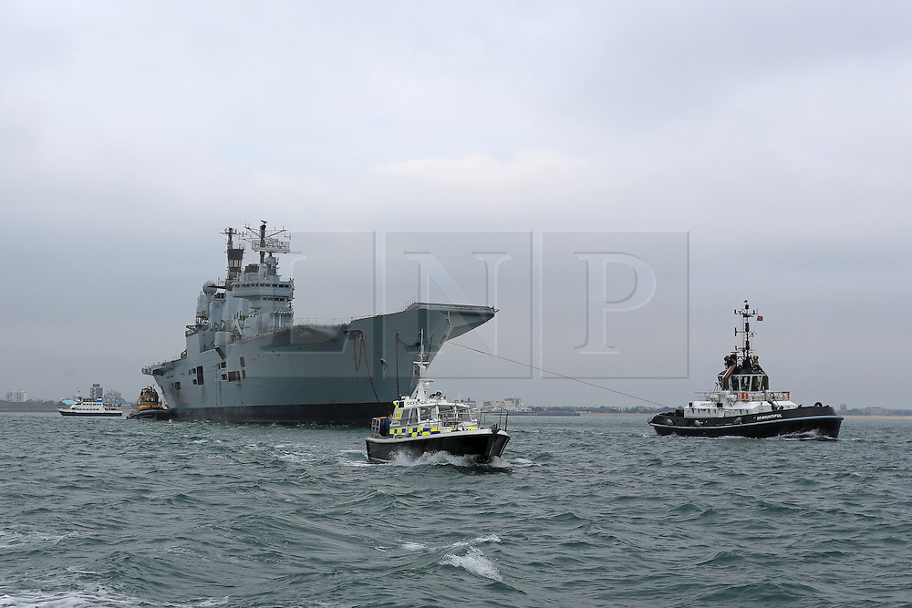 © under license to London News Pictures.  20/05/2013. The Ark Royal leaves Portsmouth for the final time today for a scrap yard in Turkey. The Royal Navy's former flagship was decommissioned early following the 2010 defence review and is being towed to Turkey for scrap. Picture credit should read: Bryan Moffat/London News Pictures