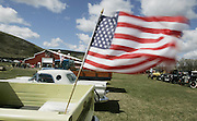 The American flag flies from the bed of &quot;Old Yeller,&quot; a 1959 Chevy Apache pickup. In the background is the new Eastern Washington Agricultural Museum. <br /> Alan Berner / The Seattle Times