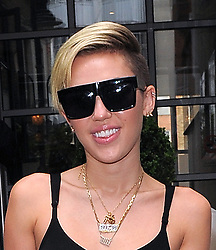 Singer Miley Cyrus dressed in high waisted black sheer trousers with a buttoned drape leg and a fitted black bra top, seen leaving a London in hotel. UK. 11/09/2013<br /> BYLINE MUST READ : GOTCHAIMAGES.COM<br /> <br /> Copyright by © Gotcha Images Ltd. All rights reserved.<br /> Usage of this image is conditional upon the acceptance <br /> of Gotcha Images Ltd, terms and conditions available at<br /> www.gotchaimages.com