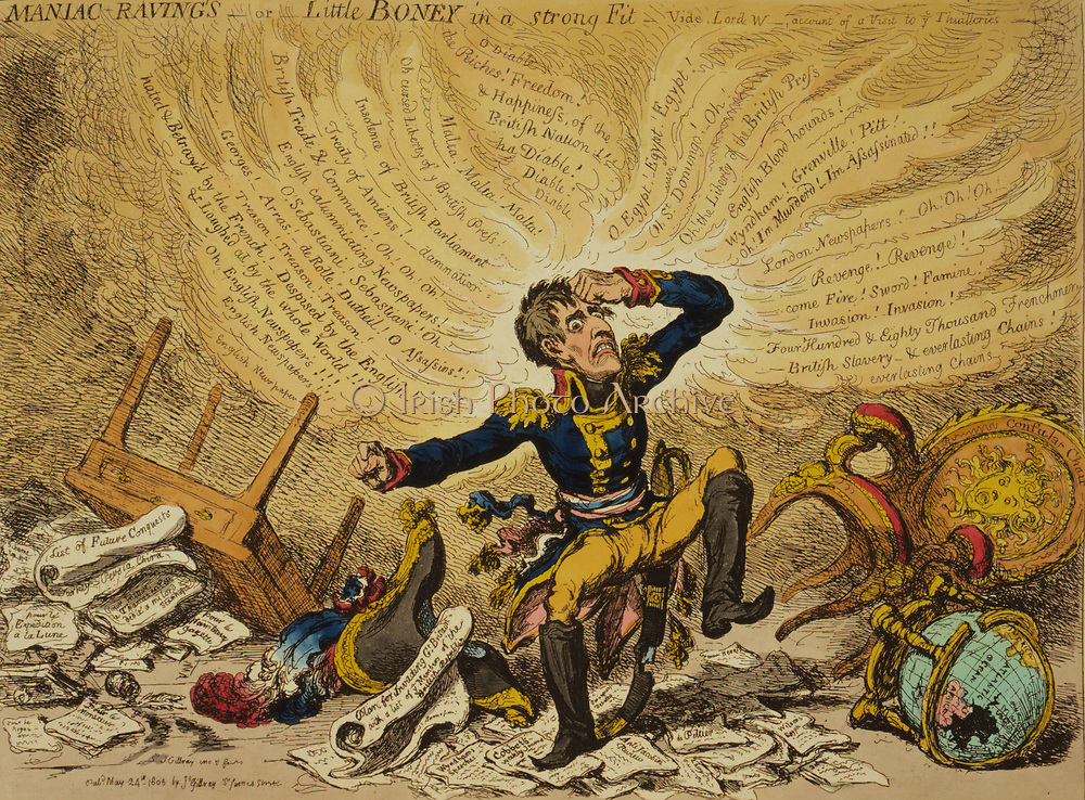 Maniac-raving's-or-Little Boney in a strong fit / Js. Gillray inv. & fect 1803. Creator James Gillray, 1756-1815, engraver. Cartoon showing Napoleon in a fury over relations between France and England.
