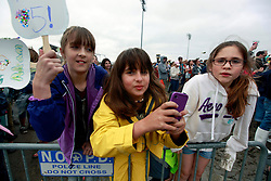 03 May 2013. New Orleans, Louisiana,  USA. .New Orleans Jazz and Heritage Festival. .Despite the mud, fans packed the Acura stage for Maroon 5. Fans and their phones..Photo; Charlie Varley.
