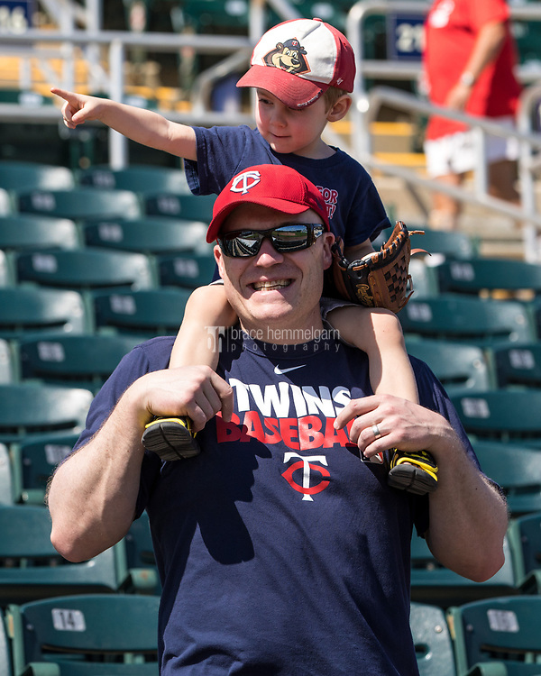 FORT MYERS, FL- FEBRUARY 27: Minnesota Twins fans, a father and his son, look on prior to the game against the Miami Marlins on February 27, 2017 at the CenturyLink Sports Complex in Fort Myers, Florida. (Photo by Brace Hemmelgarn) *** Local Caption ***