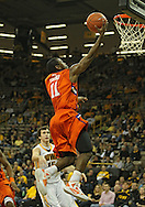 November 29, 2011: Clemson Tigers guard Andre Young (11) puts up a shot as Iowa Hawkeyes forward Zach McCabe (15) looks on during the second half of the NCAA basketball game between the Clemson Tigers and the Iowa Hawkeyes at Carver-Hawkeye Arena in Iowa City, Iowa on Tuesday, November 29, 2011. Clemson defeated Iowa 71-55 in the Big Ten-ACC Challenge game.