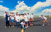 Kids from EAA 690's Aviation Summer Camp having a bit of fun in front of a Velocity.