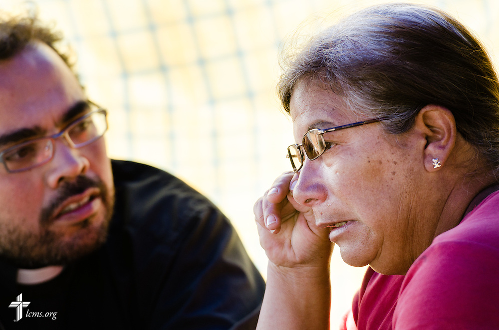 The Rev. Alejandro Daniel López Verdugo (left) of the Confessional Lutheran Church of Chile talks to a displaced earthquake victim on Wednesday, April 23, 2014, in Alto Hospicio, Chile. A magnitude 8.2 earthquake struck approximately 95km northwest of Iquique on April 1, 2014, condemning several thousand houses and severely damaging more than 10,000 others.  LCMS Communications/Erik M. Lunsford