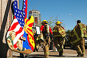 Several firefighters walk past an art exhibit of a guitar on the streets of downtown phoenix AZ.