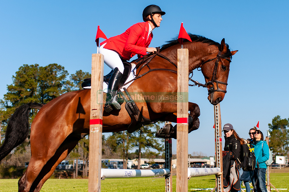 March 22, 2019 - Raeford, North Carolina, US - COLLEEN LOACH of Canada riding FOREIGN QUALITY warm-up before competing in the CCI3-S show jumping division at the sixth annual Cloud 11-Gavilan North LLC Carolina International CCI and Horse Trial, at Carolina Horse Park. (Credit Image: © Timothy L. Hale/ZUMA Wire)