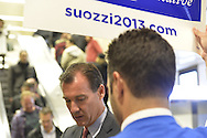 Manhattan, New York, U.S. 4th November 2013. TOM SUOZZI, Democratic candidate for Nassau County Executive, (center under  sign) meets potential voters during his campaign stop at Penn Station, near end of 36 straight hours of barnstorming across Nassau County, leading up to the November 5 general election. Former Nassau County Executive Suozzi and incumbent Republican Mangano are once again facing each other as challengers.