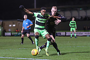 Forest Green Rovers Reece Brown(10) holds off Mansfield Town's Neal Bishop(6) during the EFL Sky Bet League 2 match between Forest Green Rovers and Mansfield Town at the New Lawn, Forest Green, United Kingdom on 29 January 2019.