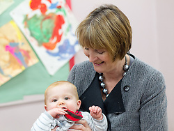 © Licensed to London News Pictures . 14/11/2012 . Manchester , UK . The Deputy Leader of the Labour Party , HARRIET HARMAN , plays with a child at a Sure Start centre at Manchester Town Hall , today (Wednesday 14th November 2012) . Harriet Harman joins Lucy Powell who is standing for the constituency of Manchester Central in the city's upcoming by-election . Photo credit : Joel Goodman/LNP