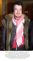 Interior designer MR NICKY HASLAM, at a party in London on 14th January 2002. OWL 192