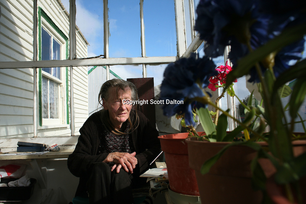 Maggie Alazia, 86, sits on her porch in Stanley, the capital of the Falkland Islands, on Saturday, March 24, 2007. Alazia was born and raised in the Falklands and was in Stanley during the war with Argentina. (Photo/Scott Dalton)