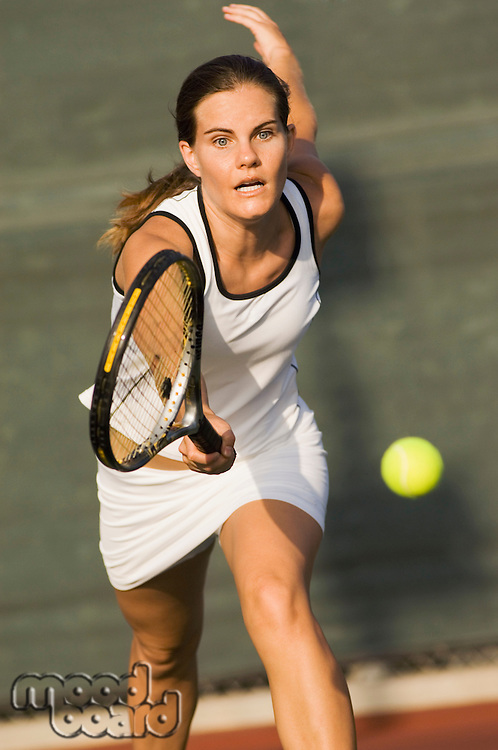 Tennis Player Reaching For Ball