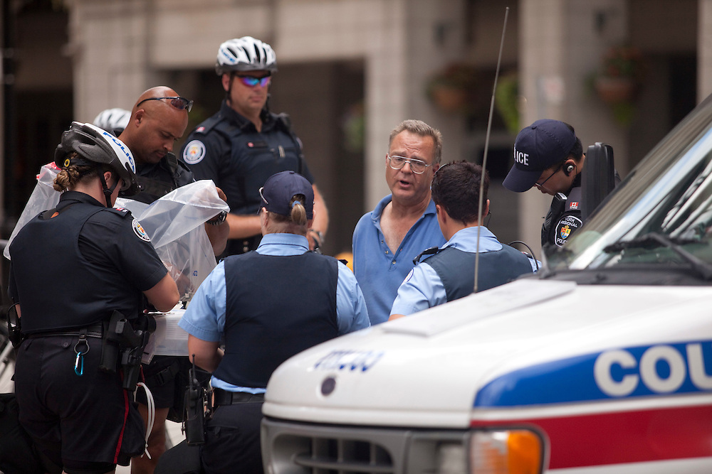 Police arrest a man who was stopped in downtown Toronto, Canada with a car full of suspicious materials June 24, 2010. Police are on high alert as world leaders have started to arrive in town for the G8/G20 summits this weekend. <br /> AFP/GEOFF ROBINS/STR