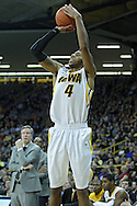 December 17, 2011: Iowa Hawkeyes guard/forward Roy Devyn Marble (4) puts up a shot during the the NCAA basketball game between the Drake Bulldogs and the Iowa Hawkeyes at Carver-Hawkeye Arena in Iowa City, Iowa on Saturday, December 17, 2011. Iowa defeated Drake 82-68.