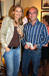 MISS SASKIA NIXDORF and LORD EDWARD MANNERS at a an exhibition of prints by art dealer Martin Summers held at 73 Glebe Place, London on 29th June 2004.