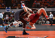 07 MARCH 2009: University of Dubuque's Josh Terrell (left) scores a takedown against Coe's Tyler Burkle in the 165-pound quarterfinal at the 2009 NCAA Division III Wrestling Championships at the US Cellular Center in Cedar Rapids, Iowa on Friday March 7, 2009. Terrell won 5-1.