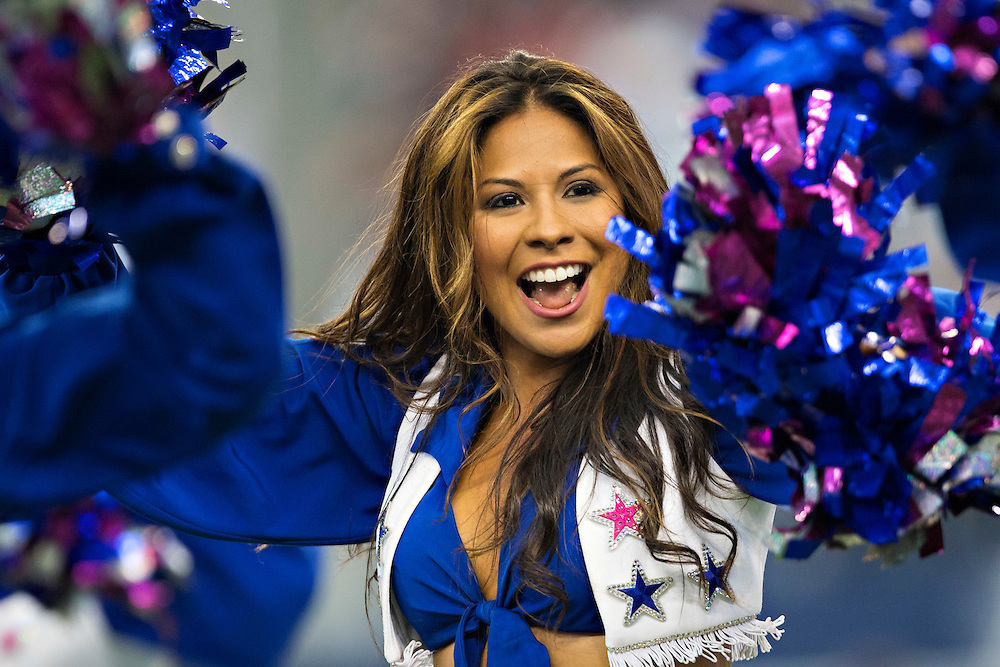 ARLINGTON, TX - OCTOBER 19:  Dallas Cowboy Cheerleader performs during a game between the Dallas Cowboys and the New York Giants at AT&T Stadium on October 19, 2014 in Arlington, Texas.  The Cowboys defeated the Giants 31-21.  (Photo by Wesley Hitt/Getty Images) *** Local Caption ***