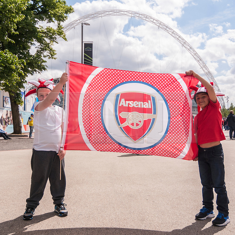© Licensed to London News Pictures. 30/05/2015. London, UK. Young Arsenal supporters hold up a flag, as fans gather at Wembley Stadium for the FA Cup Final 2015, between Arsenal and Aston Villa. Photo credit : Stephen Chung/LNP