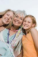 Senior woman embracing daughter and granddaughter