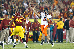 September 11, 2010; Los Angeles, CA, USA;  Virginia Cavaliers quarterback Marc Verica (6) throws over Southern California Trojans linebacker Devon Kennard (42) during the fourth quarter at the Los Angeles Memorial Coliseum. USC defeated Virginia 17-14.