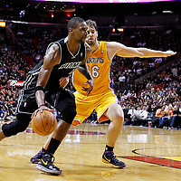 19 January 2012: Miami Heat power forward Chris Bosh (1) drives past Los Angeles Lakers power forward Pau Gasol (16) during the Miami Heat 98-87 victory over the Los Angeles Lakers at the AmericanAirlines Arena, Miami, Florida, USA.