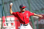 ANAHEIM, CA - APRIL  23:  Third base coach Dino Ebel #12 of the Los Angeles Angels of Anaheim throws pitches during batting practice during the game between the Boston Red Sox and the Los Angeles Angels of Anaheim on Saturday, April 23, 2011 at Angel Stadium in Anaheim, California. The Red Sox won the game in a 5-0 shutout. (Photo by Paul Spinelli/MLB Photos via Getty Images) *** Local Caption *** Dino Ebel