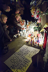 © Licensed to London News Pictures. 02/01/2012. Salford, UK. Students and mourners hold a candlelit vigil in memory of Indian student, Anuj Bidve, was was murdered on Boxing Day. The vigil, at the site of the murder on Ordsall Lane, in Salford, was organised on Facebook. 20 year old Kiaran Stapleton of Regent Square, Ordsall, Salford, has been charged with Mr Bidve's murder. Photo credit : Joel Goodman/LNP