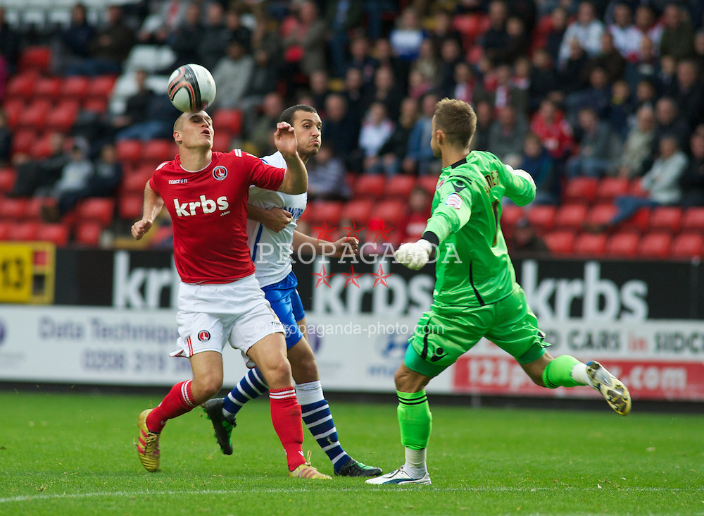 LONDON, ENGLAND - Saturday, October 8, 2011: Charlton Athletic's Michael Morrison collides into his goal keeper Ben Hamer as Tranmere Rovers' Mustafa Tiryaki fails to find the net during the Football League One match at The Valley. (Pic by Gareth Davies/Propaganda)