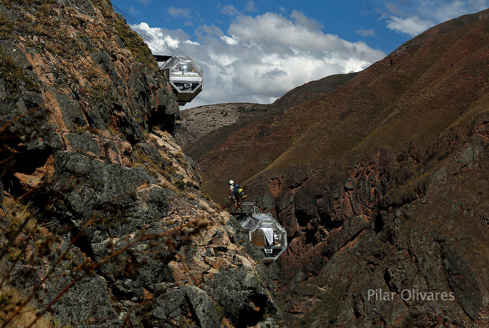 "Sleeping pods of the Skylodge Adventure Suites are pictured in the Sacred Valley in Cuzco, Peru, August 14, 2015. Tourists taking on an arduous climb up the steep cliff face of Peru's Sacred Valley are being rewarded for their efforts by being able to spend the night in transparent mountaintop sleeping pods at the ""Skylodge Adventure Suites"". To reach the pods, visitors need to climb 400 metres of via ferrata (a steel cable and rungs) up the valley side or hike an intrepid trail through zip lines. REUTERS/Pilar Olivares"