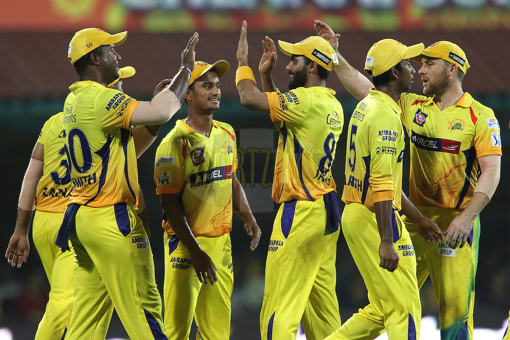 Dwayne Smith of Chennai Super Kingsis congratulated for taking the catch to get Sarfaraz Naushad Khan of the Royal Challengers Bangalore wicket during match 37 of the Pepsi IPL 2015 (Indian Premier League) between The Chennai Superkings and The Royal Challengers Bangalore held at the M. A. Chidambaram Stadium, Chennai Stadium in Chennai, India on the 4th May April 2015.<br /> <br /> Photo by:  Shaun Roy / SPORTZPICS / IPL