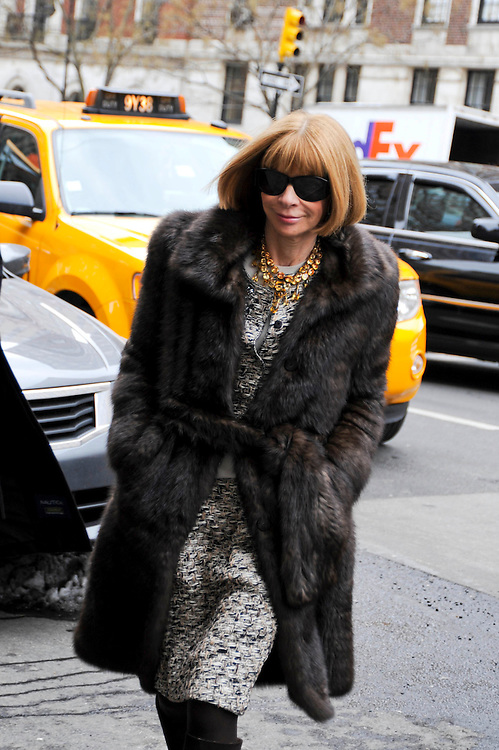 Anna Wintour in a tweed boucle suit, jeweled necklace and fur coat at the Oscar de la Renta Fall Winter 2010 show.