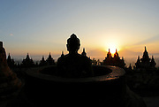 Borobudur Buddhist complex at sunrise. It was built in the 9th century and decorated with 2672 relief panels and 504 Buddha statues (Yogyakarta, Indonesia).