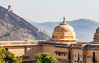 From inside the Amer Fort looking out at the outer walls on the surrounding steep hillsides. Amer, India, near Jaipur, Rajasthan, India.