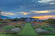 "The Kinross House is located north of Edinburgh on the western shore of Loch Leven. Looking beyond ""The Fish Gate"" you can see Lochleven Castle. Even in early October flowers are in bloom and the grass feels like fine carpet."
