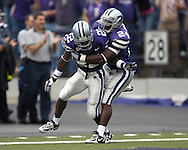Kansas State's Maurice Mack (24) celebrates with Justin McKinney (22), after McKinney's 88-yard opening Kick-Off return against Florida Athlantic at Bill Snyder Family Stadium in Manhattan, Kansas, September 9, 2006.  The Wildcats beat the Owls 45-0.