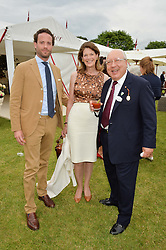 Left to right, COUNT RICCARDO LANZA and URS & FRANCESCA SCHWARZENBACH at the Cartier Queen's Cup Final 2016 held at Guards Polo Club, Smiths Lawn, Windsor Great Park, Egham, Surry on 11th June 2016.