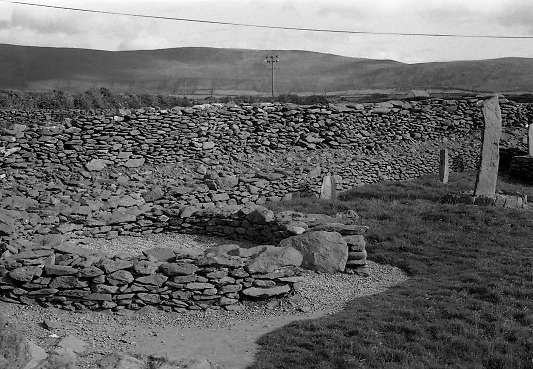 Scenes of Cork and Kerry..1986..02.09.1986..09.02.1986..2nd September 1986..Pictures of a series of scenic shots taken in the Cork / Kerry region of Ireland.Monastic site at Riasc, West of Dingle,Co Kerry. (Special thanks to Ciaran Walsh for this information.) ..Image of a hand carved standing stone depicting Celtic Design.. The stone is standing in what appears to be an ancient burial site or ritual area.