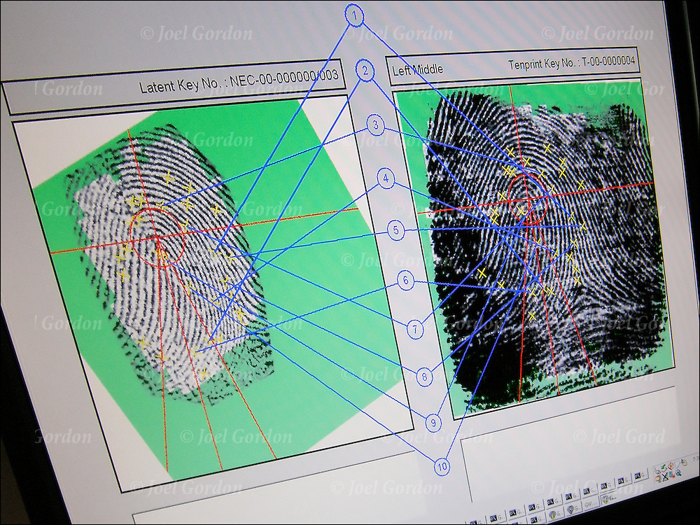 Computer Screen matching finger print points. Print on left is from crime scene to the print on the right that is on file.<br /> <br /> The rapid response of fingerprint identification through IAFIS ( Integrated Automated Fingerprint Identification System)  makes it possible to identify fugitives while they are still in police custody.