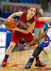 Bridgeport guard Gianina Renzelli (20) looks to pass the ball against Fairmont Senior during a first round game at the Charleston Civic Center.