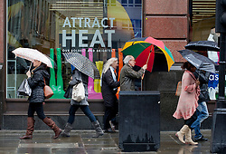 © licensed to London News Pictures. London, UK 09/04/2012. People walking on Regents Street with umbrellas as they face rain and wind in central London, this afternoon (09/04/12). Photo credit: Tolga Akmen/LNP