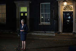 London, UK. 14th November, 2018. Prime Minister Theresa May makes a statement to the media outside 10 Downing Street following approval of a draft Brexit agreement at a five-hour emergency Cabinet meeting.