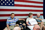 GOP Presidential candidate Rep. Michele Bachmann supporters wait for her to arrive at a town hall event in Marshalltown, Iowa, July 23, 2011.