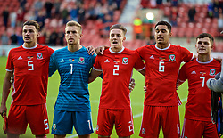 WREXHAM, WALES - Tuesday, September 10, 2019: Wales' captain Regan Poole, goalkeeper George Ratcliffe, Cameron Coxe and Benjamin Cabango stand for the national anthem during the UEFA Under-21 Championship Italy 2019 Qualifying Group 9 match between Wales and Germany at the Racecourse Ground. (Pic by David Rawcliffe/Propaganda)