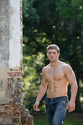 shirtless muscular All American man walking outdoors