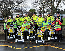 Police officers and children with the 'pop up' school kids who will be positioned outside schools across the country as part of a new Police Scotland school road safety initiative.<br /> <br /> © Dave Johnston/ EEm