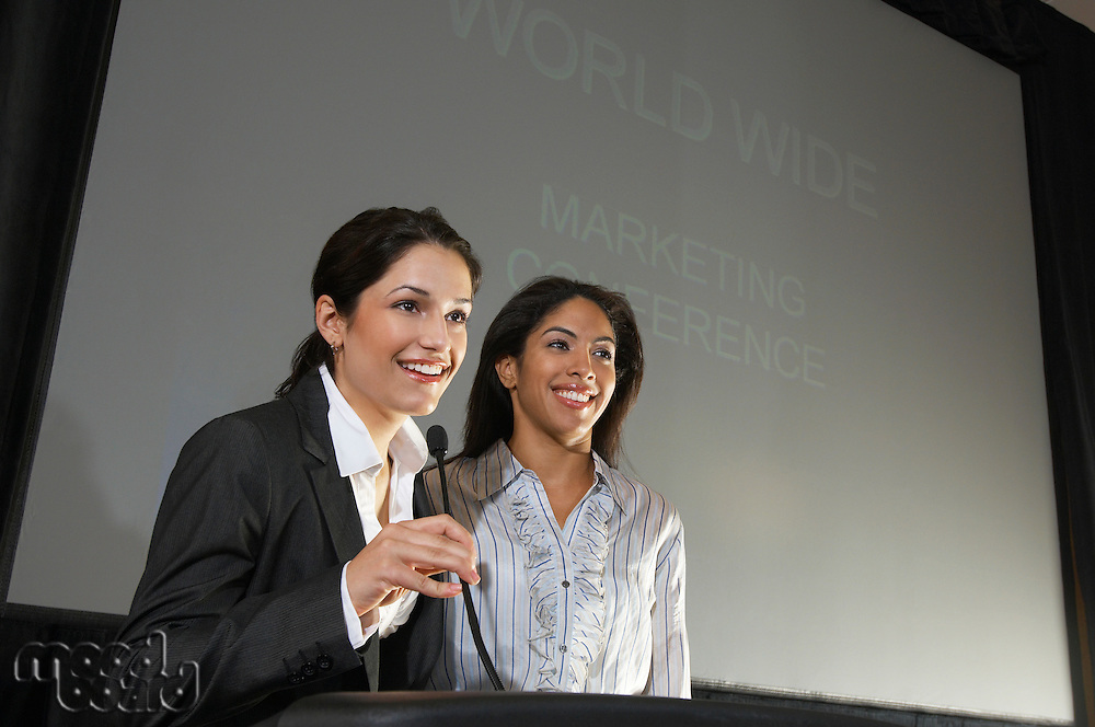Two women speaking during conference