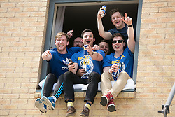 © Licensed to London News Pictures. 07/05/2016. Leicester, UK. Leicester City fans celebrating outside the King Power stadium before their match with Everton before lifting the Premiership trophy. Pictured, lads in an over looking hotel, egg on the crowd chants. Photo credit: Dave Warren/LNP